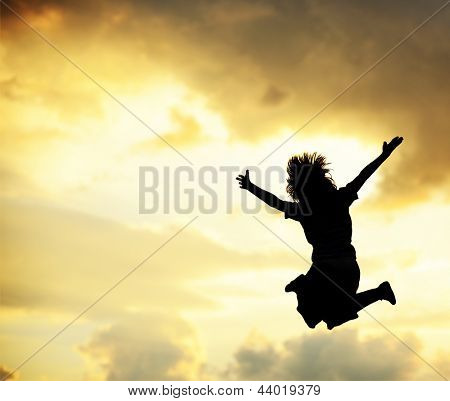 Boy jumping outdoor for joy happiness and freedom