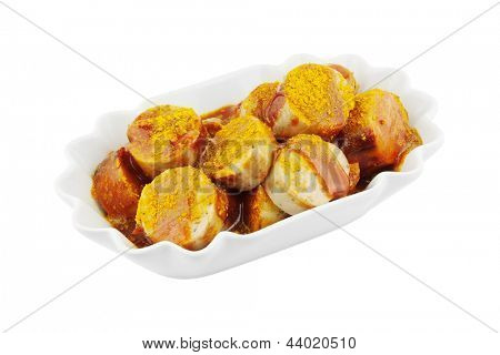 Bowl of currywurst isolated on white
