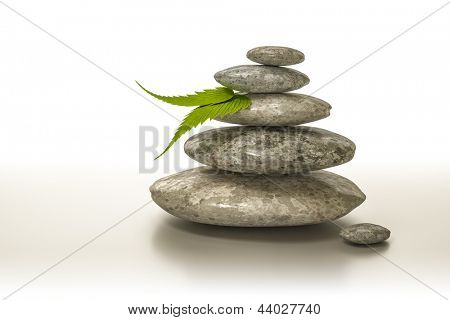 An image of a stone pyramid with 2 green leaf