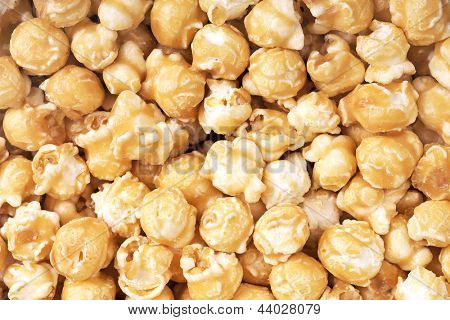A background of fresh toffee coated popcorn
