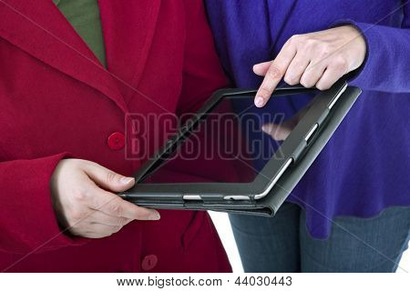 Two women with a digital tablet, detail