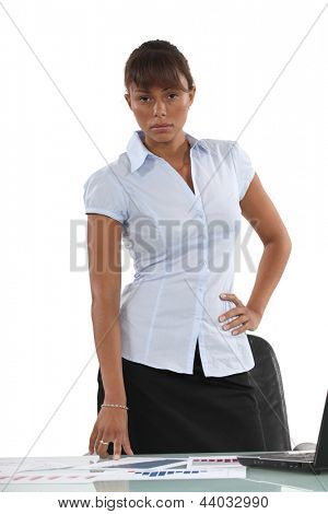 Serious employee in front of her desk
