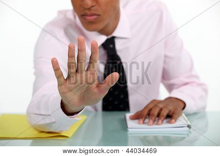 Businessman making a stop gesture