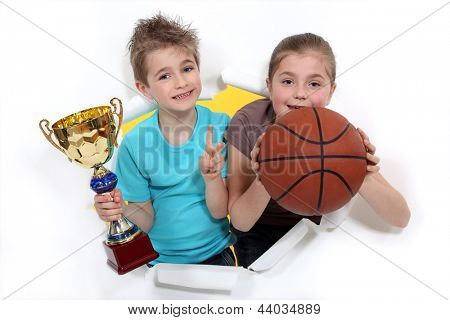Young basketball players holding a trophy
