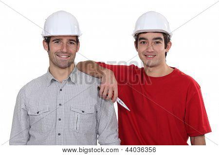 duo of craftsmen all smiles