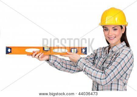 Tradeswoman holding a spirit level