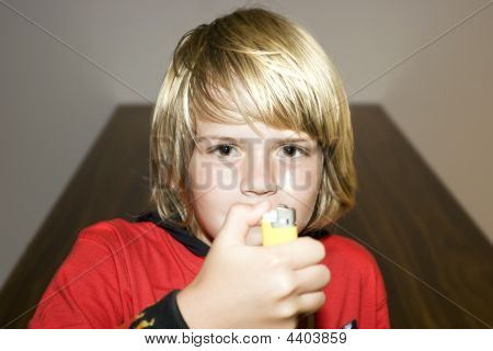 Blond-haired Child At Home With Firelighter