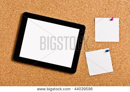 touch tablet with note papers on cork board