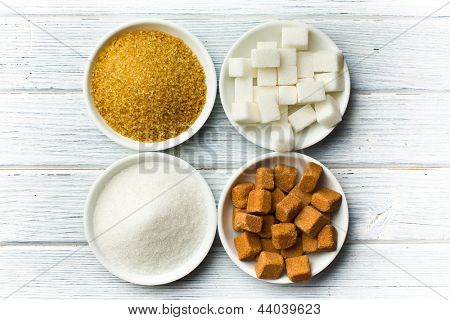 various types of sugar in ceramic bowls