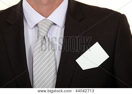 close-up on business card on businessman's suit
