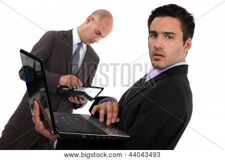 Two businessmen preparing for important sales pitch