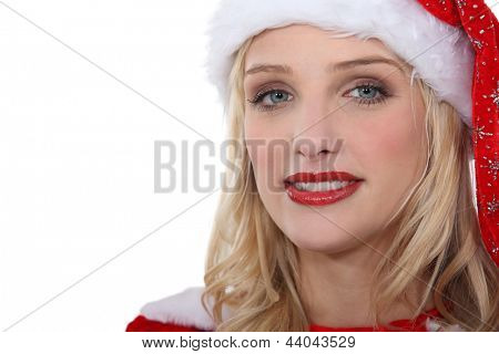 Portrait of woman with Santa hat