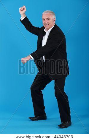 Senior businessman pretending to ride horse