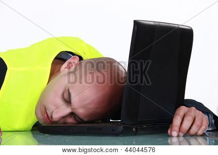 Laborer sleeping on a computer