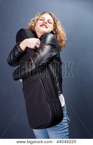 happy smiling girl hold her violin studio shot