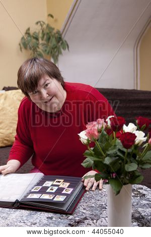 Mentally Disabled Woman Looks At Stamps