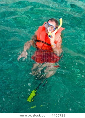 Man In The Life Vest And Diving Mask