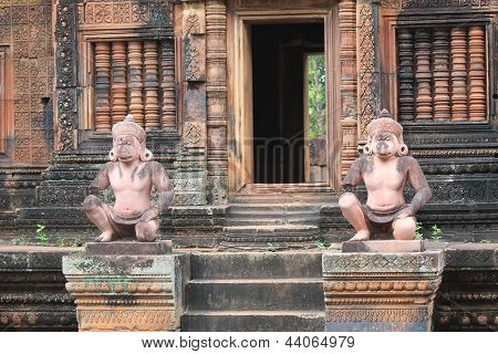 Carved Stone Guardian Statues In Banteay Srei, Cambodia