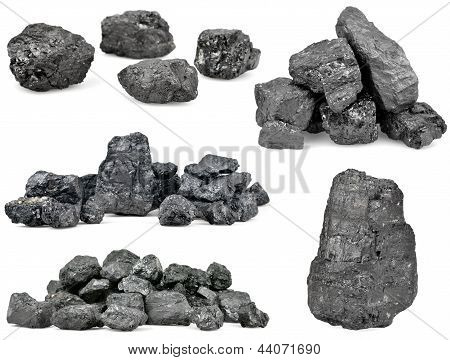 Set Of Piles Of Coal Isolated On White
