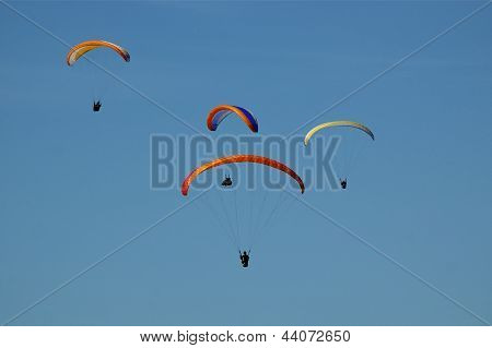 Formation Of Four Hang-Gliders in Sky