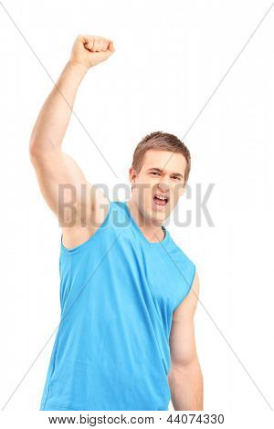 Young euphoric sportsman with raised hand gesturing happiness isolated on white background