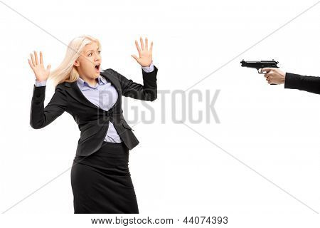 Afraid young businesswoman from a gun isolated on white background