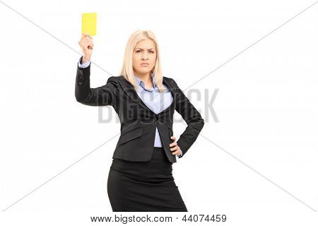 Angry businesswoman holding a yellow card isolated on white background