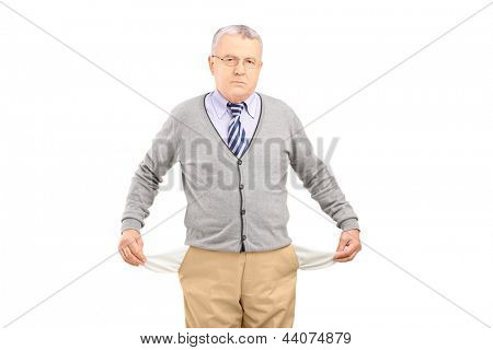 Senior man with empty pockets, isolated on white background
