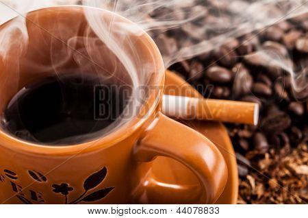 Cigarette, smoke and a cup o coffee