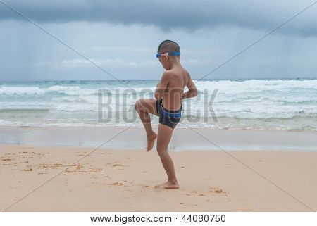 Playful Boy And Hermit Crab On The Beach With Sea  On Background At Phuket Island,thailand