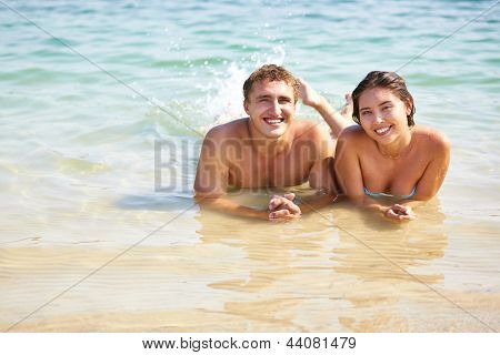 Portrait of cheerful holiday-makers enjoying their summer together