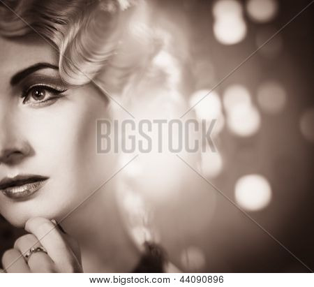 Toned portrait of elegant blond retro woman  with beautiful hairdo