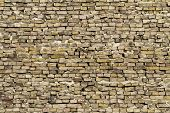foto of errat  - Loosely stacked up yellow brick wall background - JPG