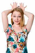 foto of splayed  - Beautiful cheerful girl with fingers spread over his head - JPG