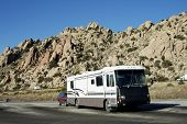 stock photo of motor coach  - recreational vehicles parked at an interstate rest area in Arizona - JPG