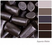 A background of cut pieces of liquorice in a colour palette with complimentary colour swatches