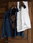Clothes Hanging On Wardrobe Closet