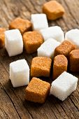 brown and white sugar cubes on wooden table