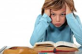 stock photo of homework  - Boy exasperated with his homework - JPG