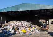 image of waste management  - rubbish piled up at a waste management centre - JPG
