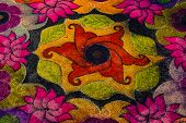 image of kolam  - Indian street art made of dyed sand - JPG