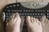 picture of physically handicapped  - typing by foots  - JPG