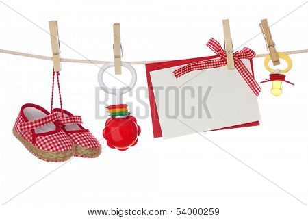 Baby goods and blank note hanging on the clothesline