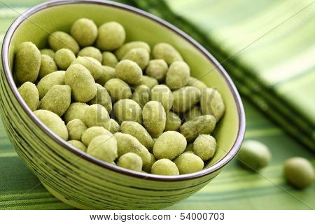 Wasabi peas in green bowl