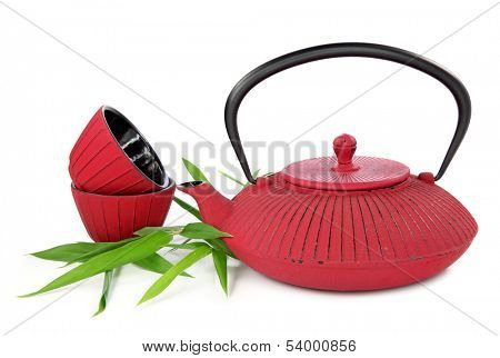 Traditional Japanese teapot and cups isolated on white background