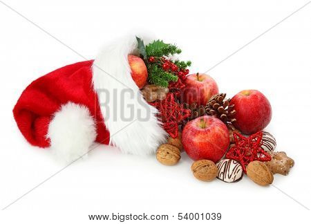 Santa claus hat filled with christmas food