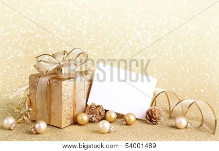 Christmas gift box with christmas balls and blank note