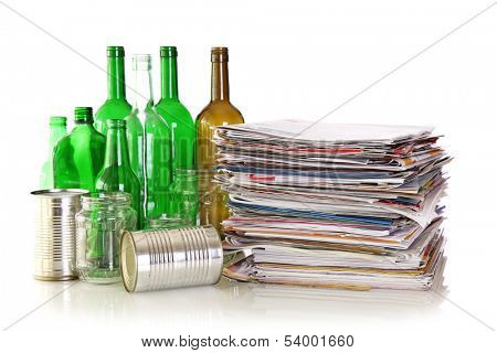 Glass bottles,  metal cans and newspapers ready for recycling