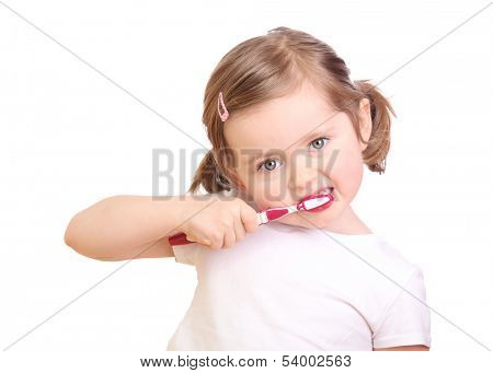 Little girl brushing her teeth isolated on white background