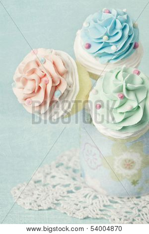 Colorful cupcake pops on blue